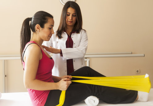 Patient doing some special exercises under supervision of physical therapist