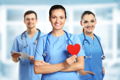 Young female doctor with red heart and medical team
