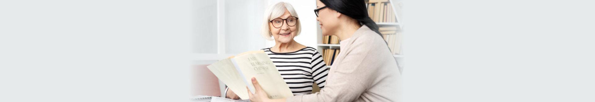 senior and caregiver talking